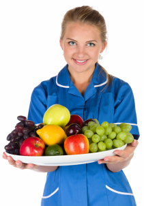 Understanding Weight Loss Basics - Nurse With Bowl of Fruit